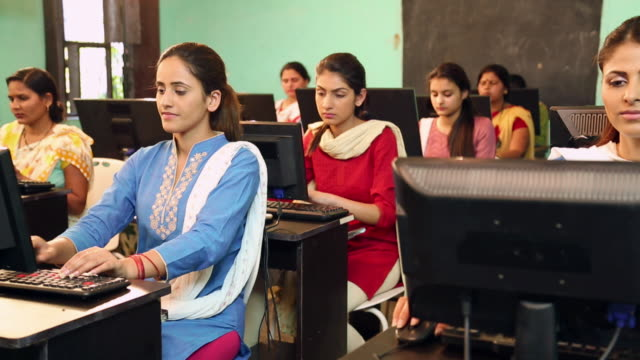 group of university students studying on computer in the classroom, sonipat, haryana, india - person in further education stock videos & royalty-free footage