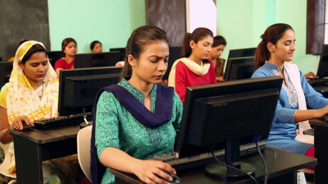 Group of university students studying on computer in the classroom, Sonipat, Haryana, India