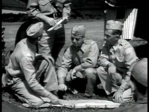philippines group of us pilots crouched down looking at map on ground ws pilots standing up bomber bg soldiers start to run pre wwii - military personnel stock videos & royalty-free footage