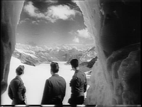 group of us soldiers on mountain side swiss flag waving above pan right to show view / montage of train ride through swiss alps soldiers walking... - zweiter weltkrieg stock-videos und b-roll-filmmaterial