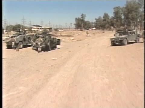 group of various military vehicles departs. - al fallujah stock videos & royalty-free footage