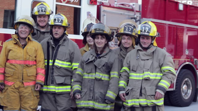 pan, group of volunteer fire fighters in front of fire truck, eastville, virginia, usa - firefighter stock videos and b-roll footage