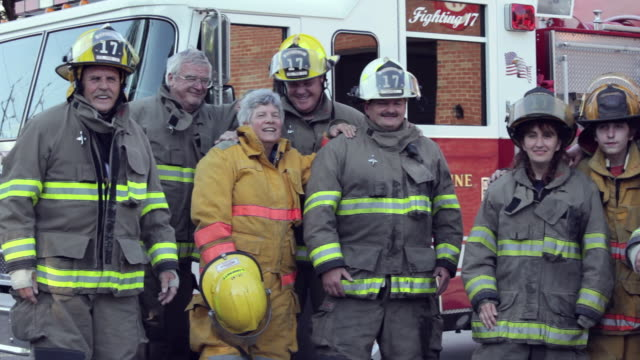 stockvideo's en b-roll-footage met pan, group of volunteer fire fighters in front of fire truck, eastville, virginia, usa - virginia amerikaanse staat