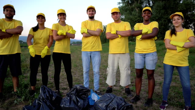 group of volunteer in the park - yellow stock videos & royalty-free footage