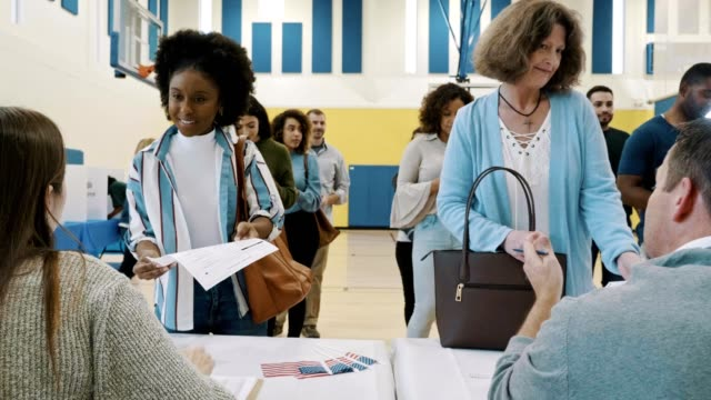 group of voters receive ballots at polling place - voting stock videos & royalty-free footage