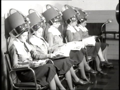 A group of WACs in uniform have their hair done at a beauty salon