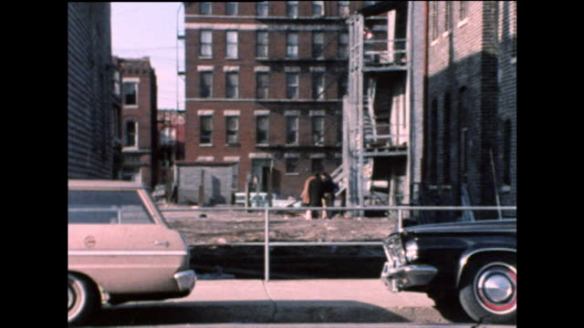 zo group of well-dressed men talking chicago ghetto; 1971 - run down stock videos & royalty-free footage