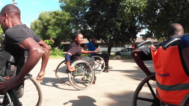 group of wheelchair basketball players fast circling around the ground - drive ball sports stock videos & royalty-free footage