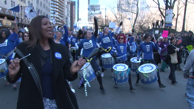 a group of women drummers perform while marching in the protest march / thousands of people many of them students march against gun violence in... - march for our lives video stock e b–roll