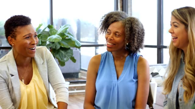 group of women encourage one another during support group - group therapy stock videos & royalty-free footage