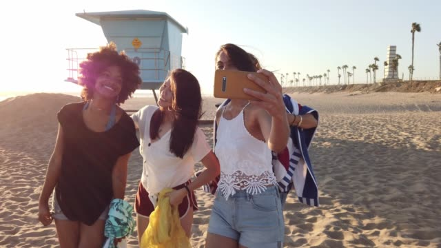 group of women friends on the beach in california - quartet stock videos & royalty-free footage