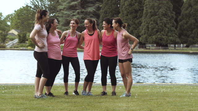 group of women gathering before a run - breast cancer stock videos & royalty-free footage