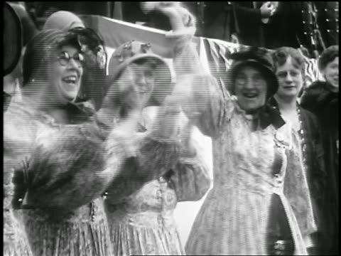 b/w 1929 group of women in 19th c dress waving at civil war veteran's parade / portland me / news - 19th century style stock videos & royalty-free footage