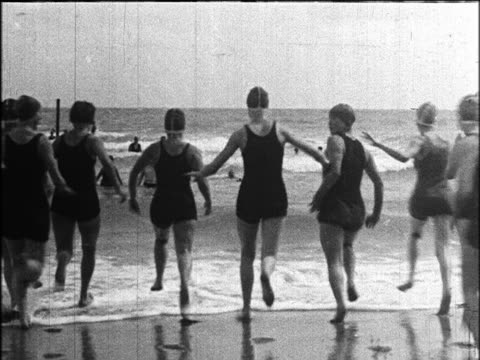 B/W 1924 REAR VIEW group of women in swimsuits running into surf / Miami Beach, Florida / industrial