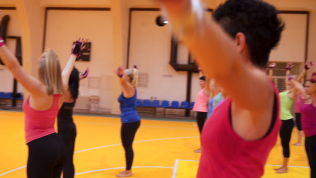 group of women mixed age range exercising together - mixed age range stock videos & royalty-free footage