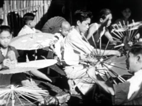 vídeos y material grabado en eventos de stock de group of women painting sunshades - java