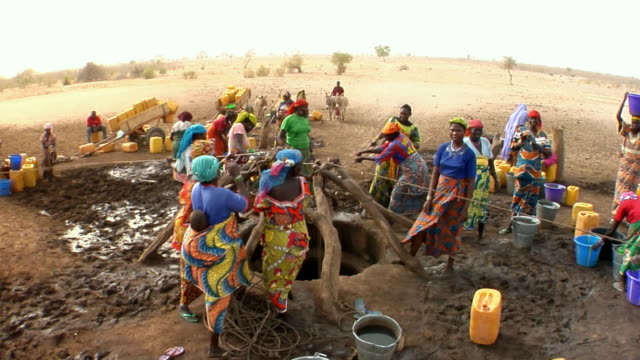 ha, ws, group of women pulling water from well, niamey, niger - etnia video stock e b–roll