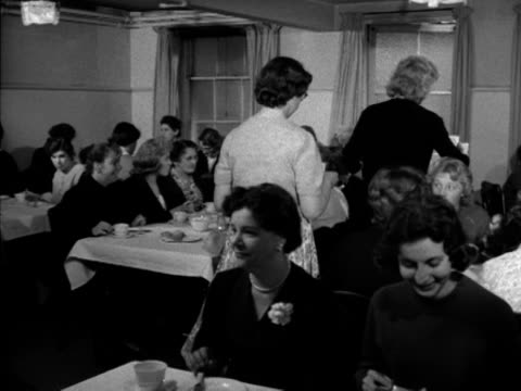 vídeos y material grabado en eventos de stock de a group of women sit down for dinner at a hostel for female employees of barker's department store 1956 - hostal