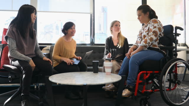 group of women, some with cerebral palsy sitting down having a meeting - stock video - equal opportunity employer stock videos & royalty-free footage