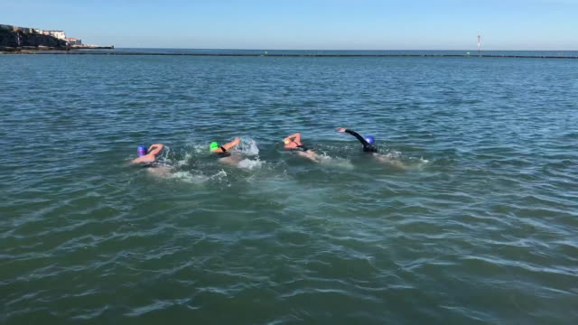 group of women swimming in sea - swimming cap stock videos & royalty-free footage