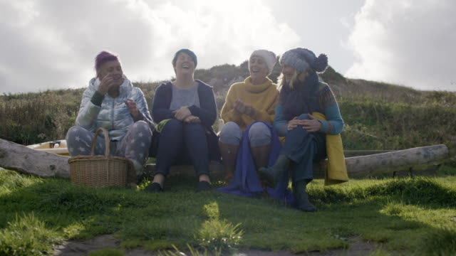 a group of women take a break - hanging out drinking coffee and laughing together. - group of people stock videos & royalty-free footage