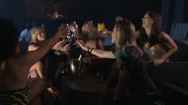 ms group of women talking and drinking together in bar / london, uk - nightlife stock videos & royalty-free footage
