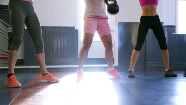 group of women training with kettle bells - exercise equipment stock videos and b-roll footage