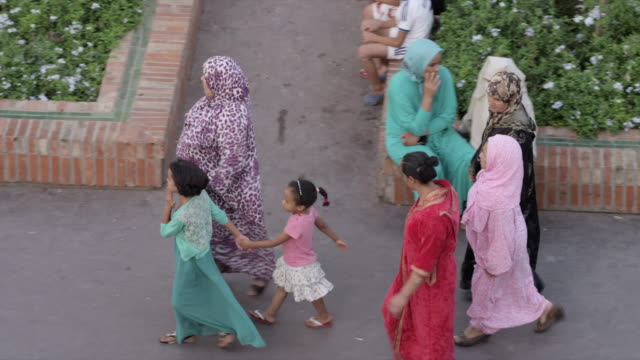 group of women walk down sidewalk - islam stock videos & royalty-free footage
