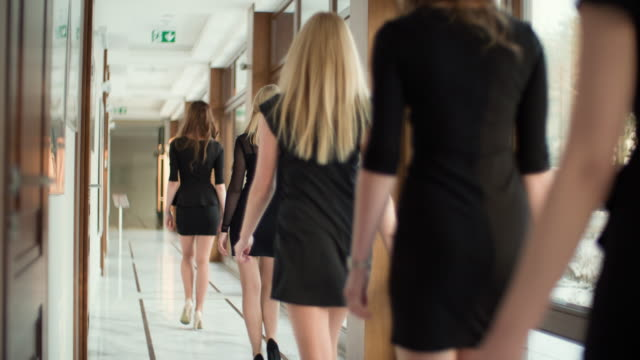 group of women walking in office corridor - business people in a row stock videos & royalty-free footage