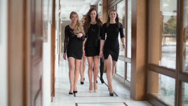 group of women walking in office corridor - conference event stock videos & royalty-free footage