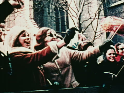 group of women watching parade for john glenn waving pom poms / nyc / newsreel - 1962 stock videos & royalty-free footage