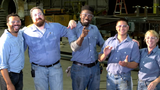 group of workers wearing safety glasses laugh at camera - foreman stock videos and b-roll footage