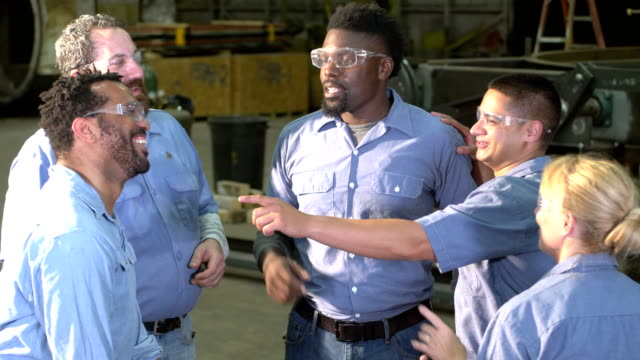 group of workers wearing safety glasses talk and laugh - safety glasses stock videos & royalty-free footage