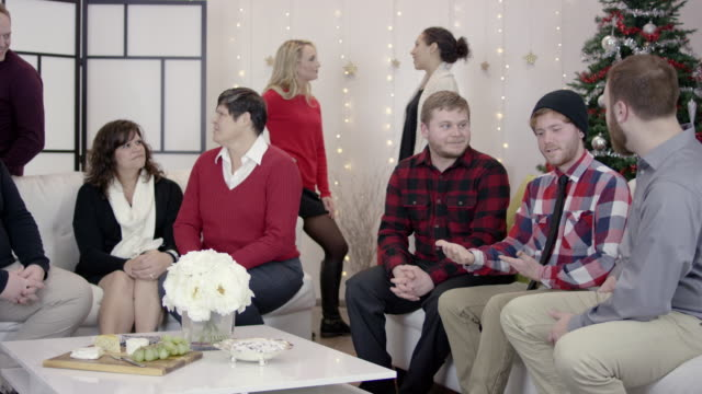 4k uhd: group of young adults at a lgbtq holiday party - intersex stock videos and b-roll footage