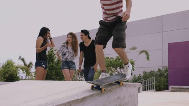 group of young adults skateboarding and having fun - 失敗点の映像素材/bロール