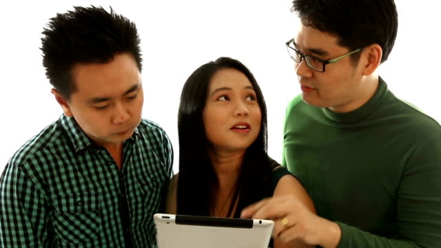 group of young adults using tablet together