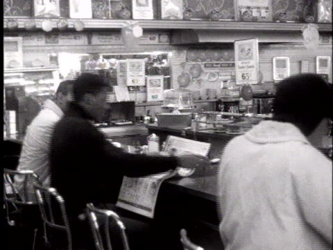 group of young african-americans participate in a sit-in at the lunch counter inside an atlanta department store during an integration protest. - lunch stock videos & royalty-free footage