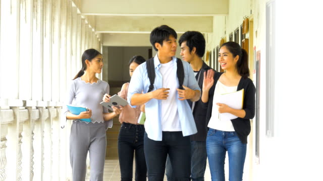 group of young asian students teenagers with school folder study reading book going to classroom at campus. education and teenage concept - study stock videos and b-roll footage