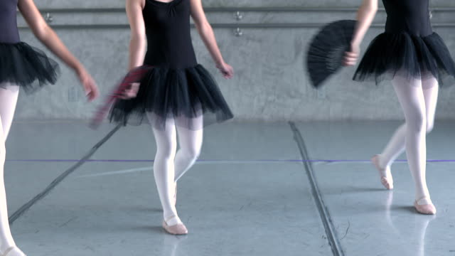 stockvideo's en b-roll-footage met ws td tu pan group of young ballerina girls performing spanish themed dance piece while holding flamenco fans in their hands / rancho mirage, california, united states  - flamencodansen