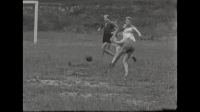 a group of young boys playing football with shots and fouls / shot in 1957 - athleticism stock videos & royalty-free footage