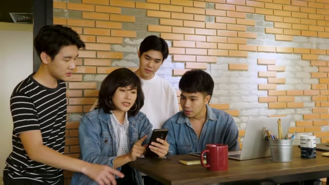 group of young business people discussing and working together for new project in creative office - thai ethnicity stock videos & royalty-free footage
