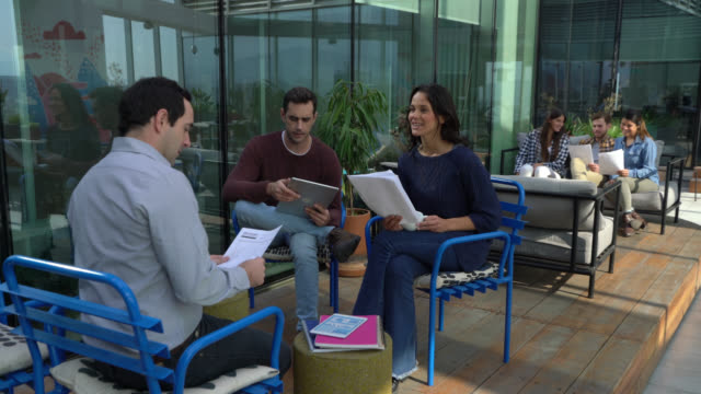 group of young business people working at the rooftop terrace - casual clothing stock videos & royalty-free footage