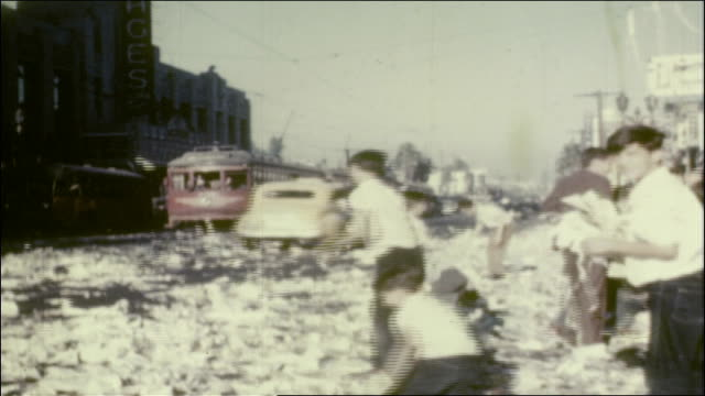 group of young caucasian boys tossing and throwing piles of paper confetti at cars driving down hollywood boulevard, trolley cars and pantages... - allied forces stock videos & royalty-free footage