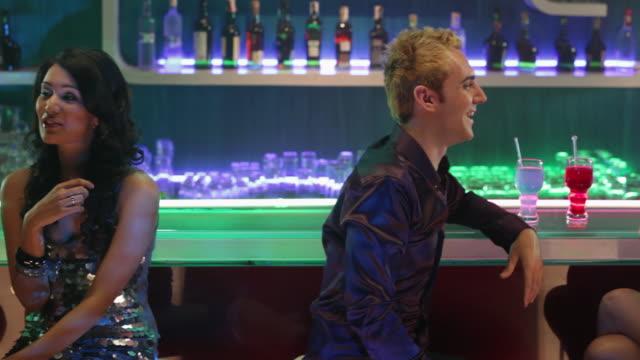 Group of young couple enjoying at bar counter