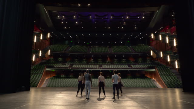 vidéos et rushes de group of young dancers on stage starting dance rehearsal. - danse classique