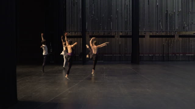 group of young dancers rehearsing on stage. - theateraufführung stock-videos und b-roll-filmmaterial