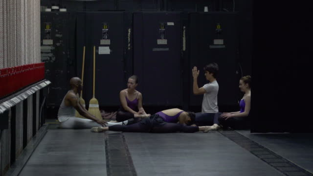 group of young dancers warming up at side of stage. - backstage stock videos & royalty-free footage