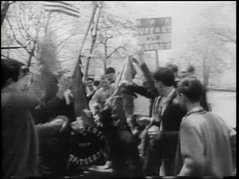 b/w 1967 group of young men burning communist flag at provietnam war demonstration / nyc - anti communism stock videos & royalty-free footage