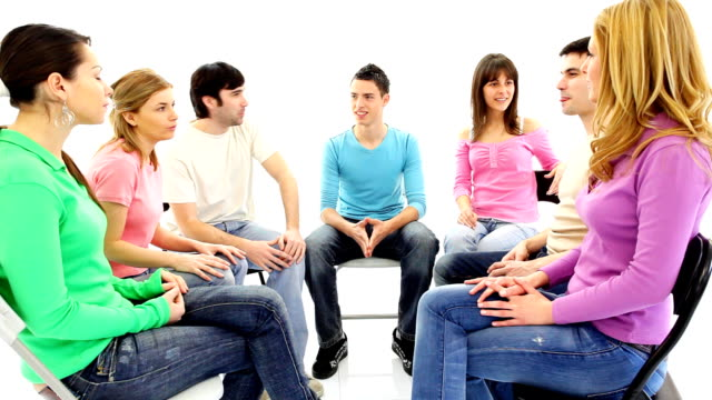 Group of  young people discussing together.