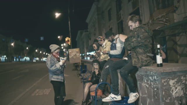 group of young people drinking alcohol and sitting outside - bench stock videos & royalty-free footage